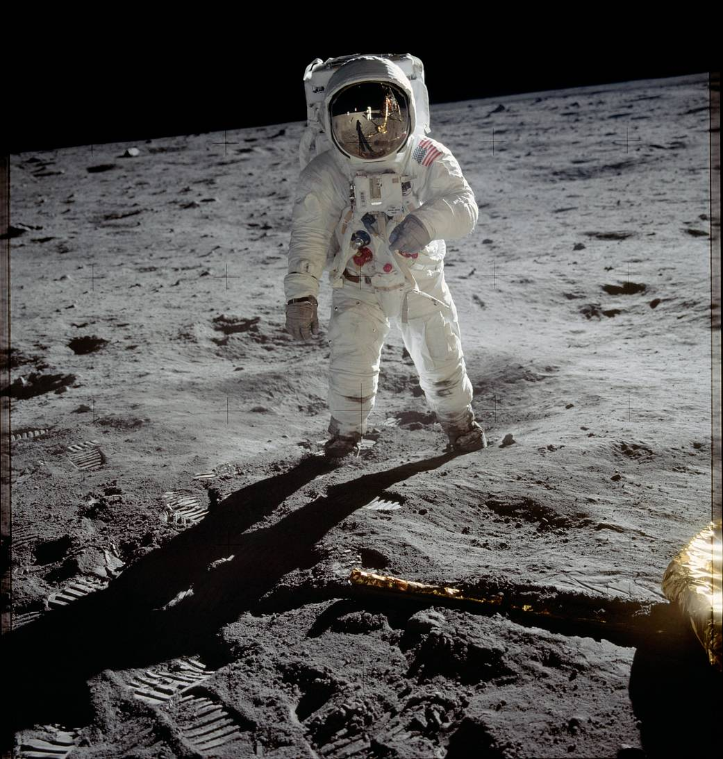 Astronaut Buzz Aldrin in spacesuit walking on lunar surface