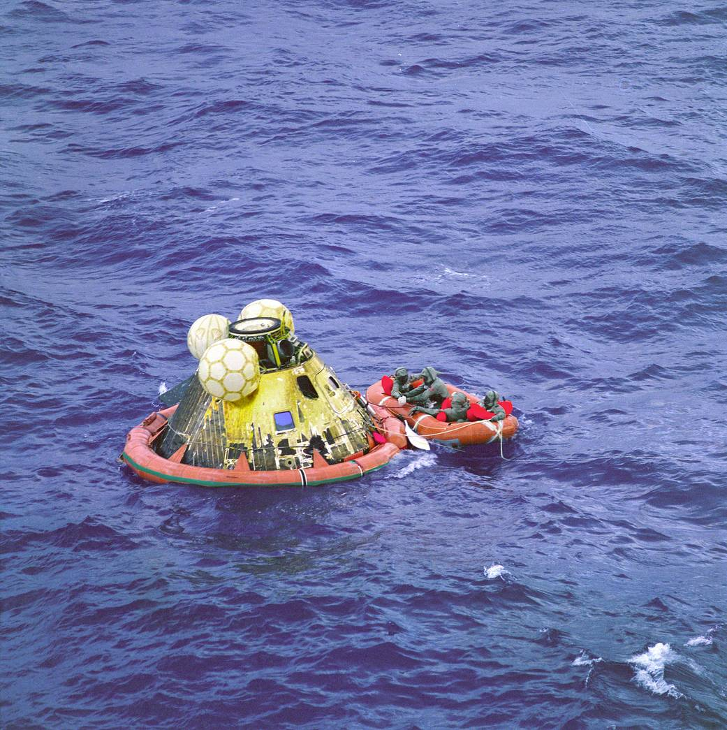 Apollo 11 crew after splashdown await pickup by helicopter from the USS Hornet, NASA photoSource: NASA
