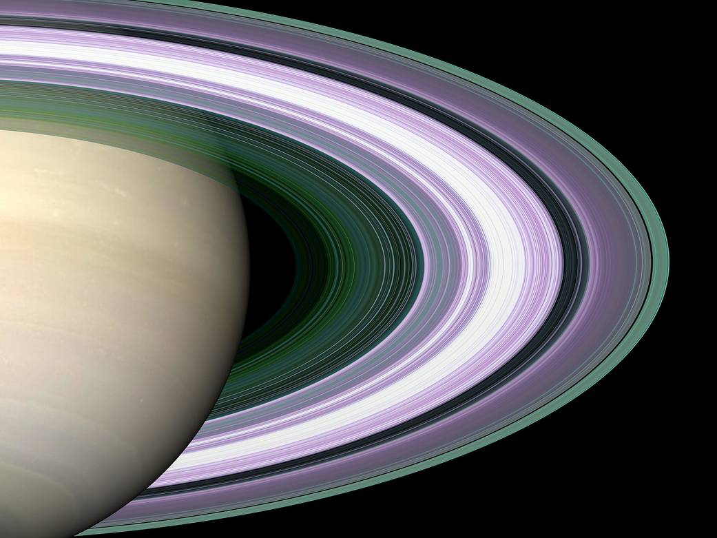 Closeup of right half of Saturn with rings in gold and violet colors
