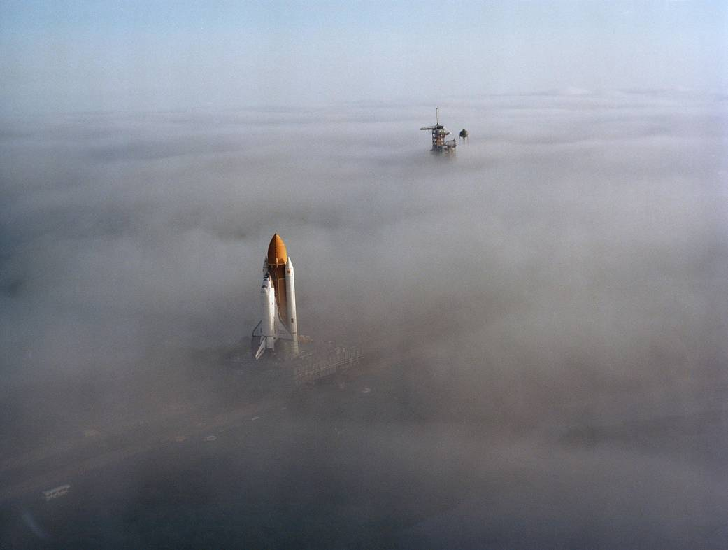 Shuttle Challenger being rolled to launch pad amid heavy fog