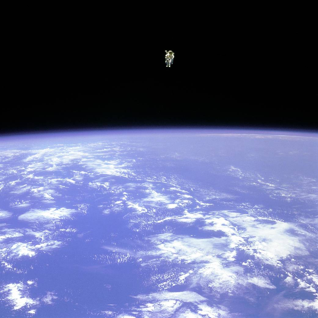 Astronaut Bruce McCandless floats in space using a jetpack