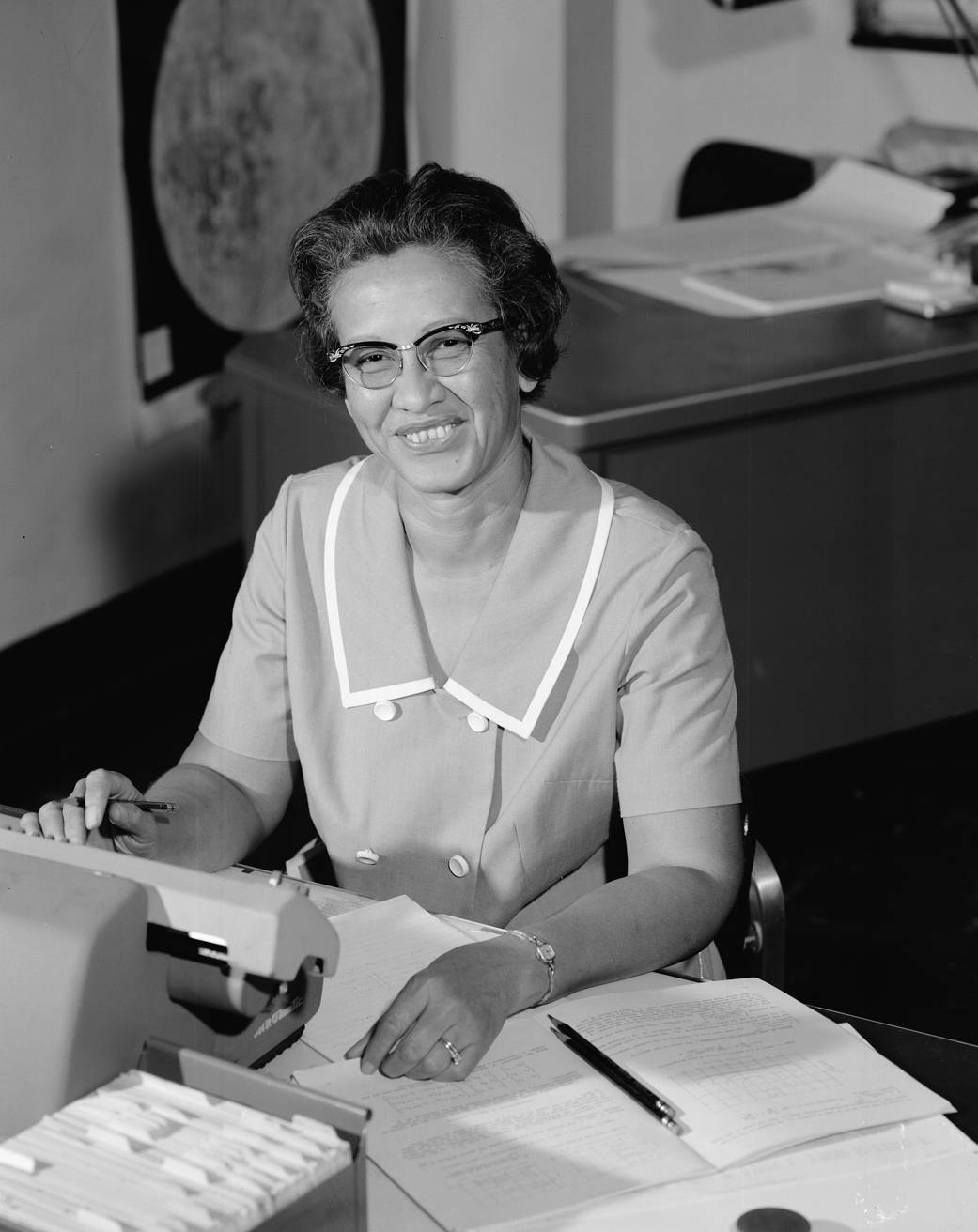 NASA research mathematician Katherine Johnson works at her desk at NASA Langley Research Center in 1966.