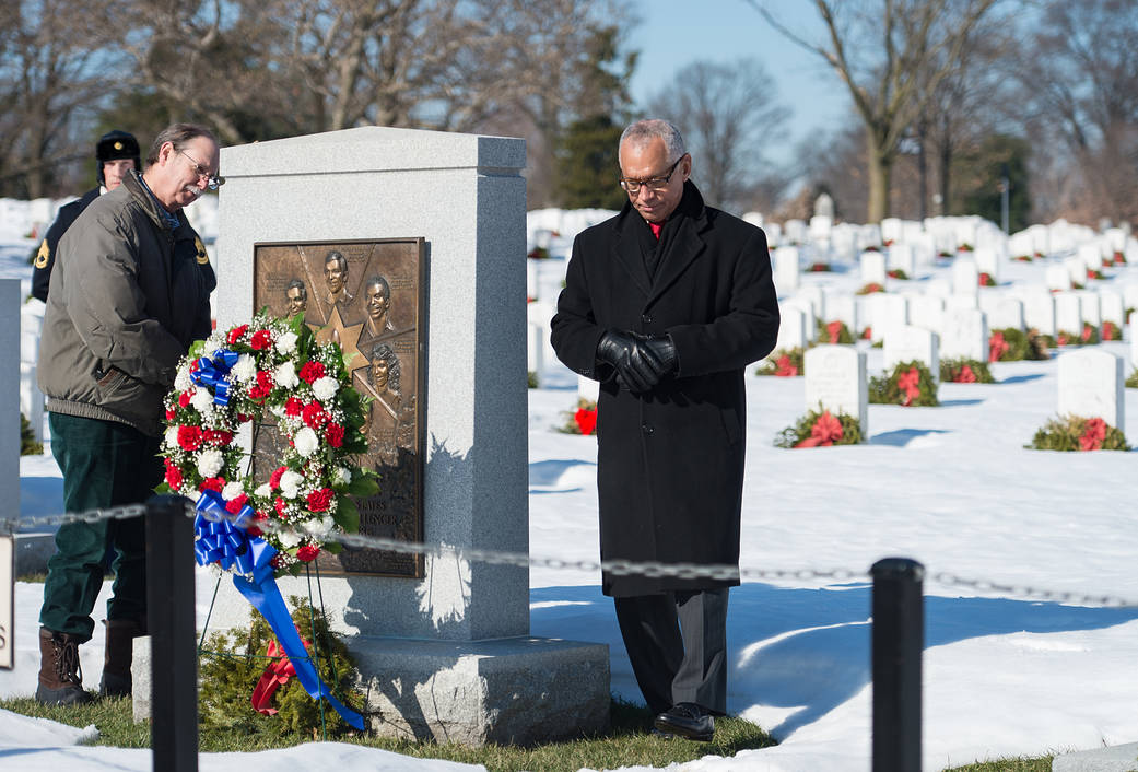 Chuck Resnik and NASA Administrator Charles Bolden at Challenger Memorial at Arlington National Cemetery with wreath in front