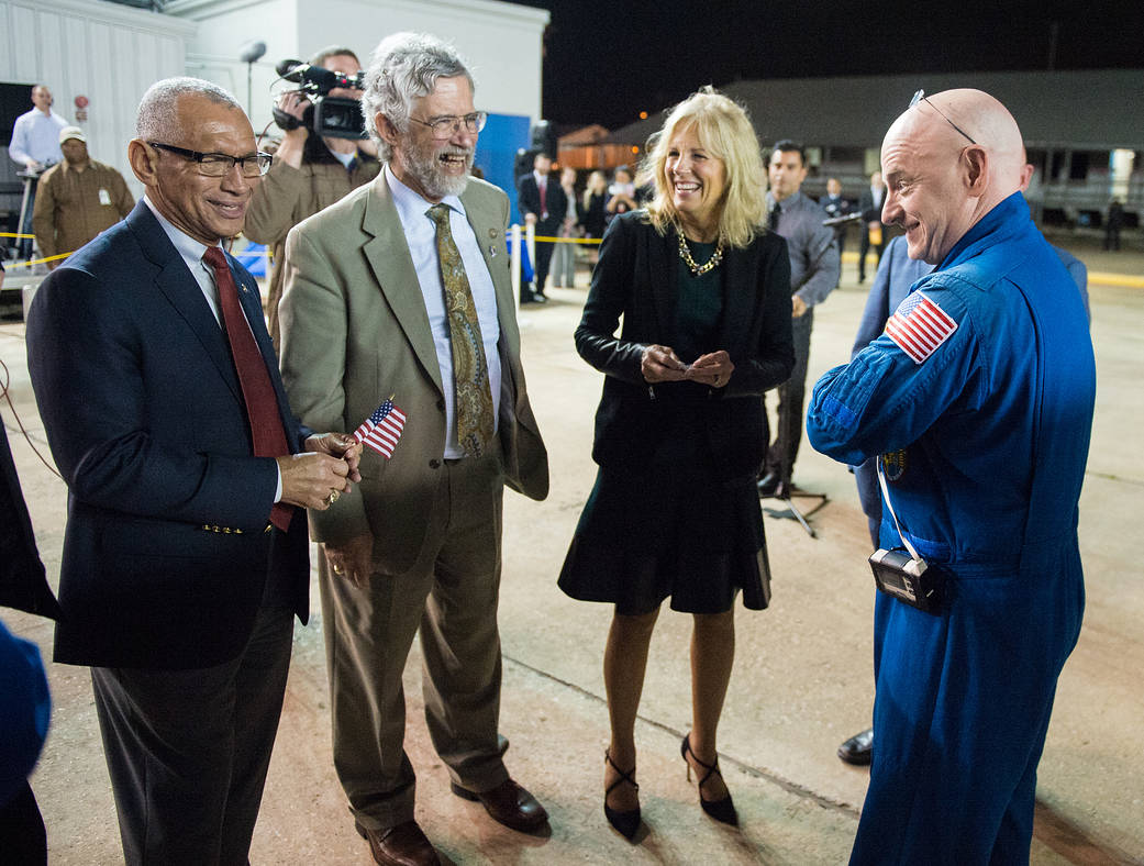 Expedition 46 Commander Scott Kelly of NASA, right, is seen with NASA Administrator Charles Bolden, left, Dr. John Holdren, dire