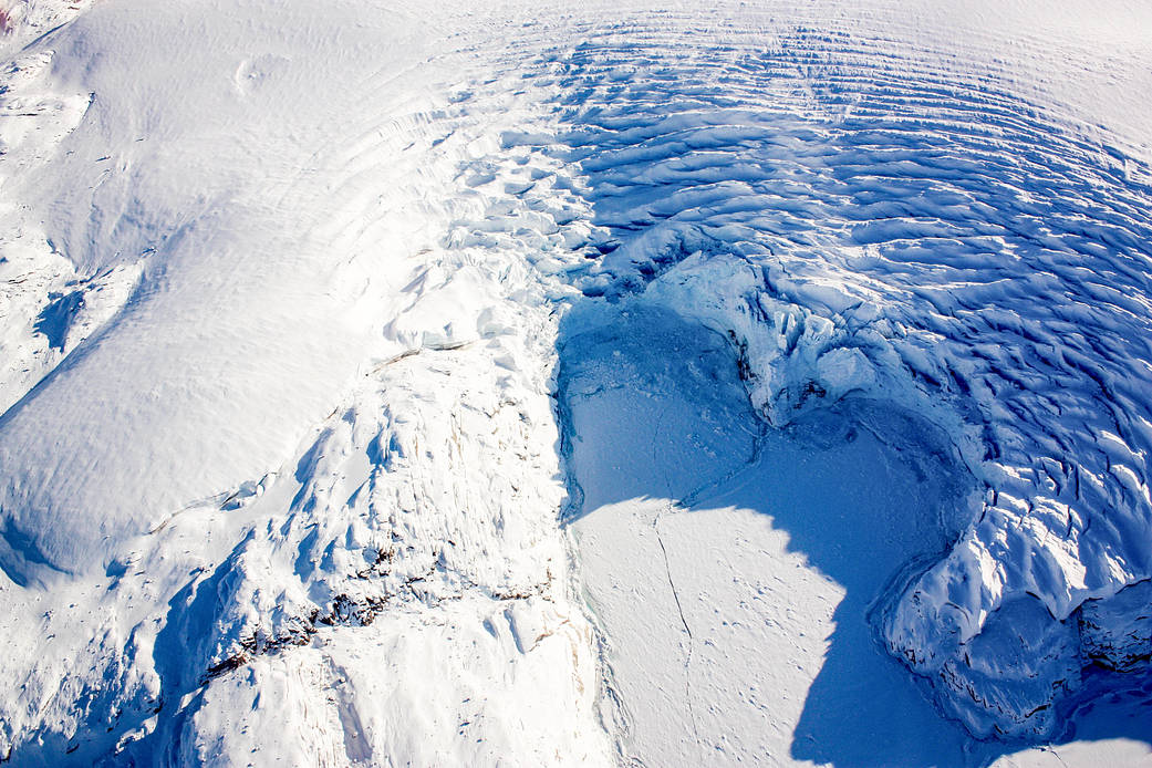 heart-shaped calving front of a glacier in northwest Greenland, as seen during an Operation IceBridge flight on Mar. 27, 2017
