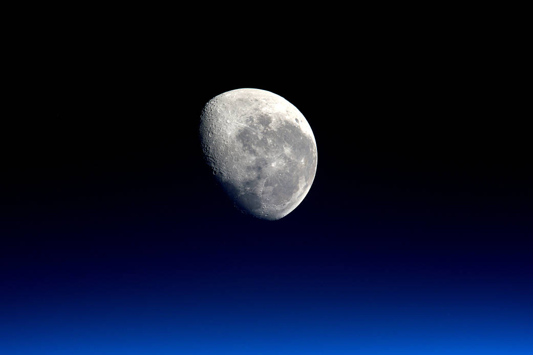 Earth's moon photographed from low Earth Orbit with blue at bottom of frame