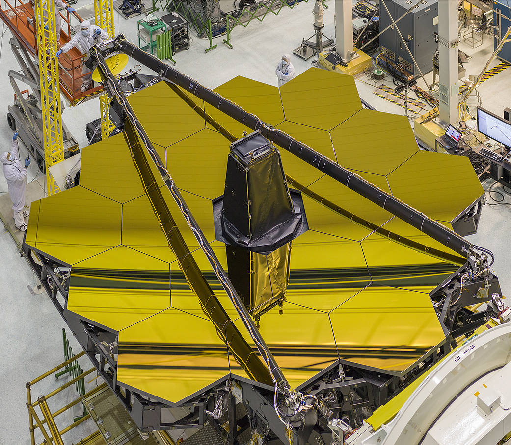 Overhead view of Webb Telescope with hexagonal gold mirrors uncovered
