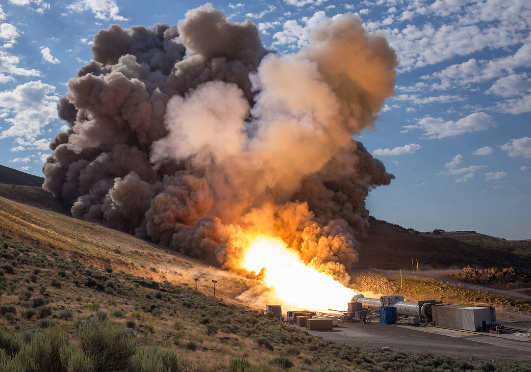 Rocket booster horizontal on ground fires up for test