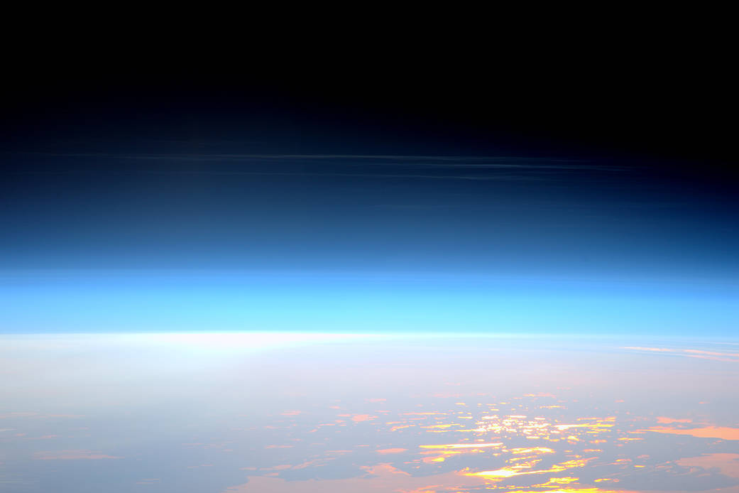 High altitude clouds photographed from orbit with Earth surface below
