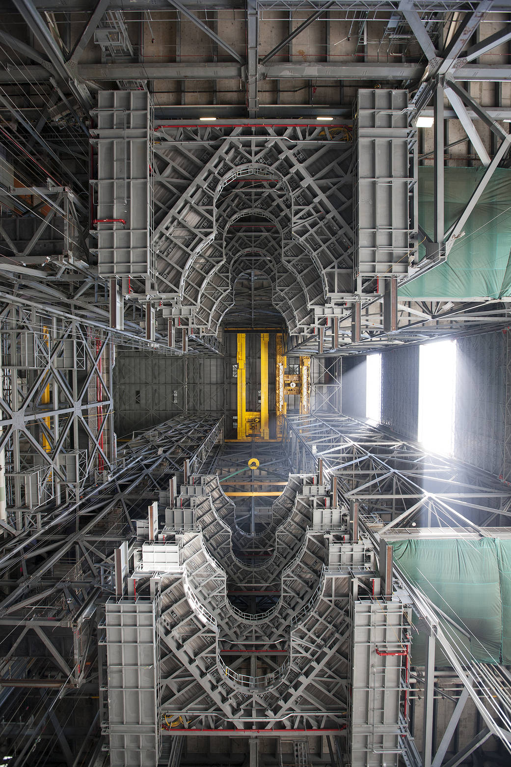 View of upper floors of Vehicle Assembly Building taken from ground