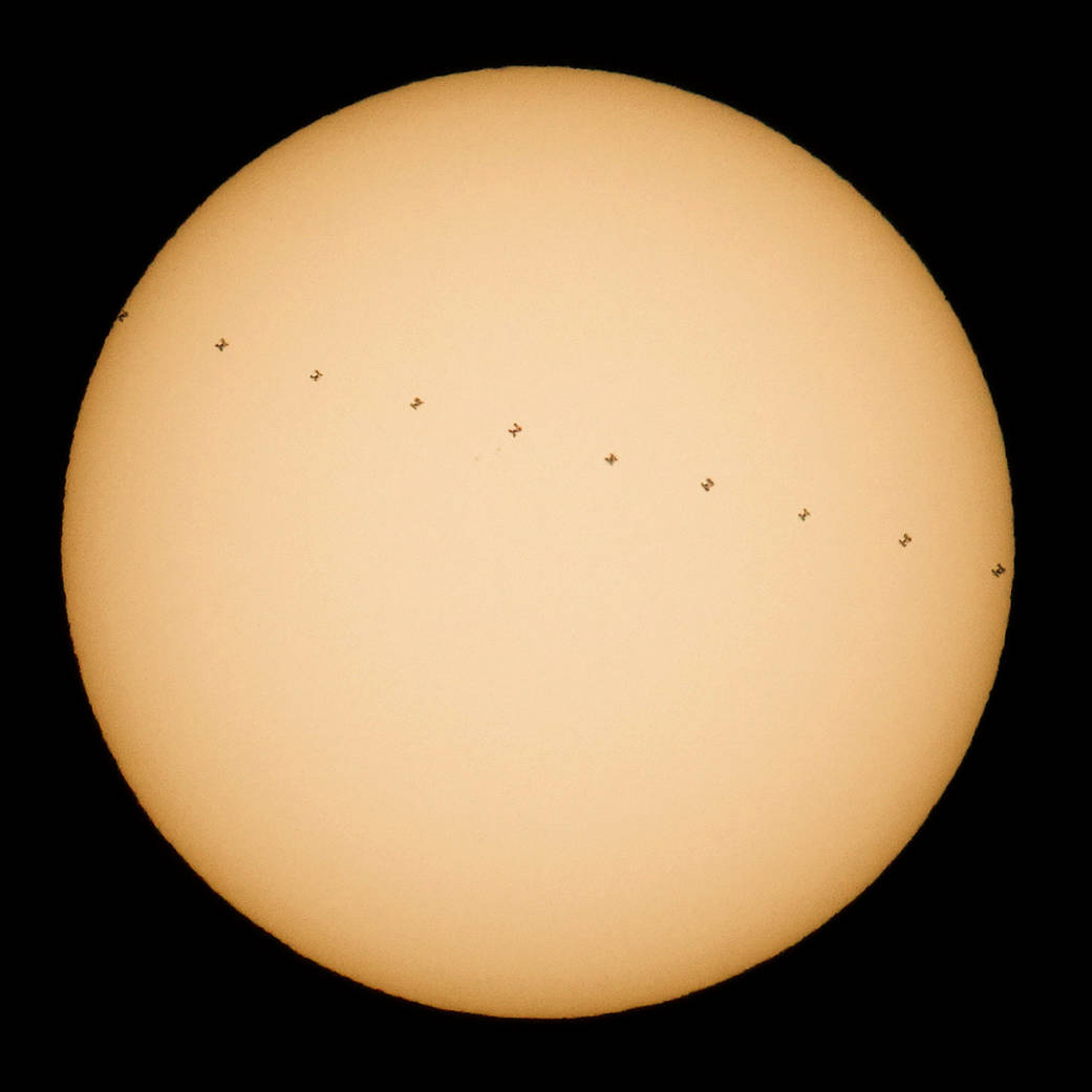 Composite image of sun with space station transiting