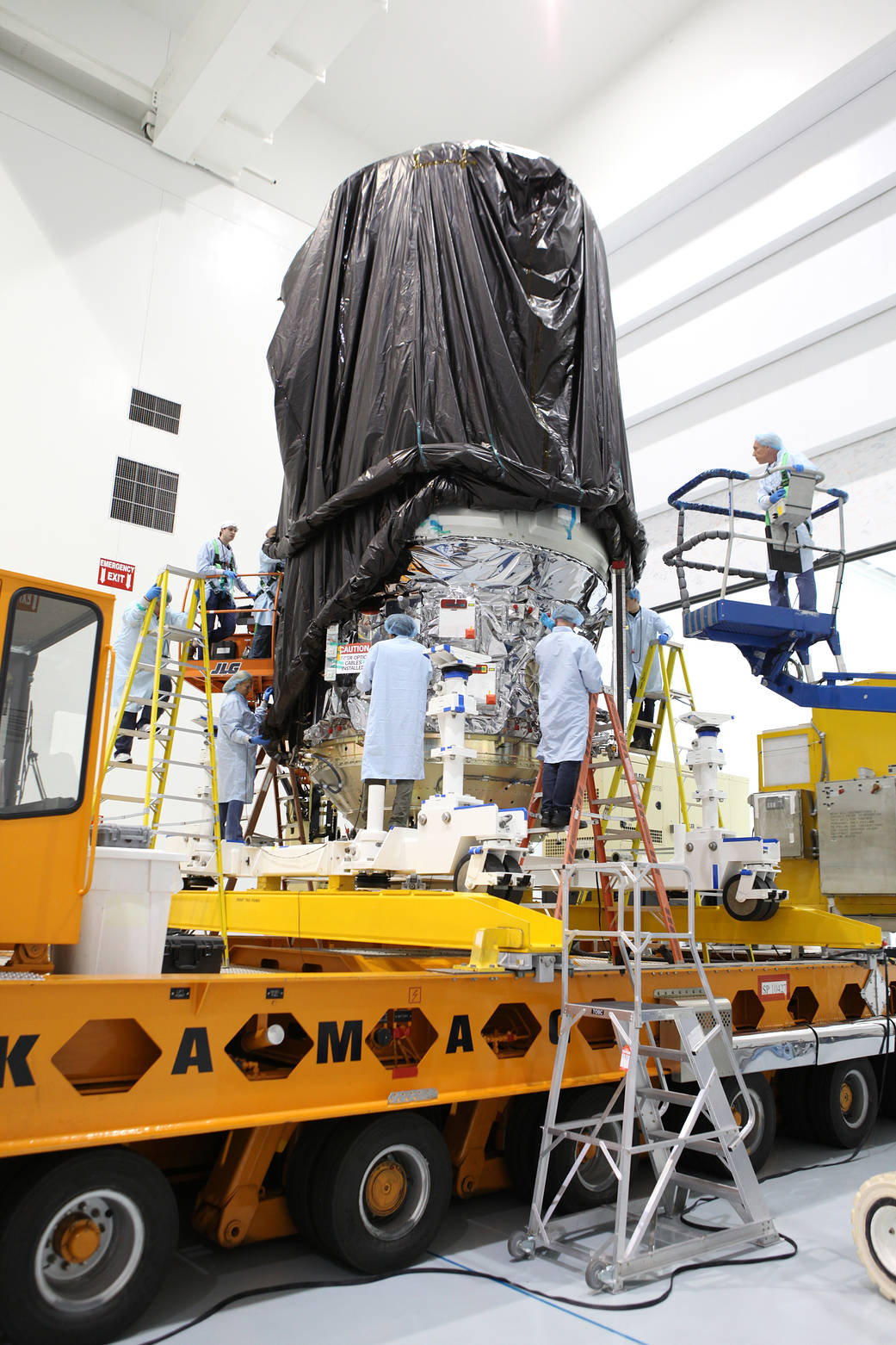 Technicians Secure the Protective Covering Around CYGNUS.