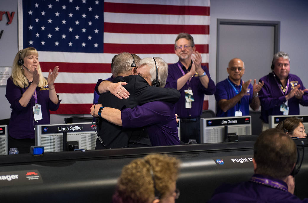 Cassini managers embrace at mission control