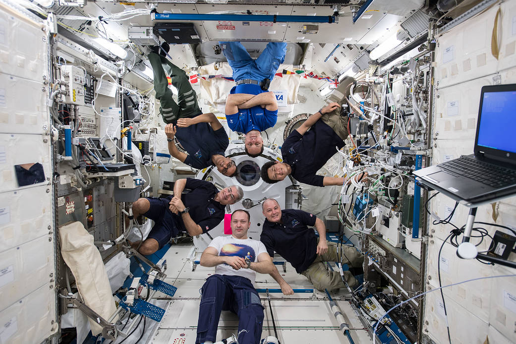 Six Expedition 54 crew on space station pose for group photo