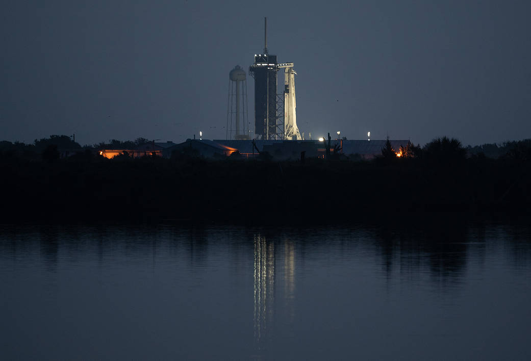 Crew Dragon spacecraft onboard is seen illuminated on the launch pad at Launch Complex 39A
