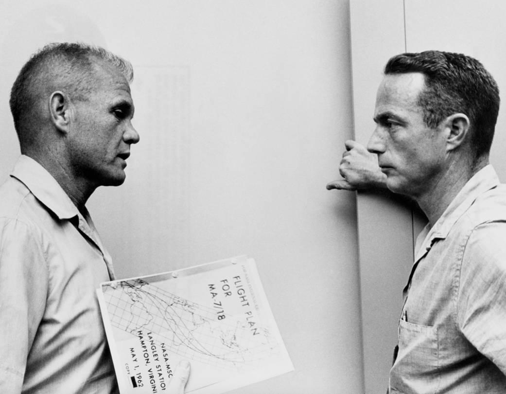 John Glenn and Scott Carpenter with flight plan