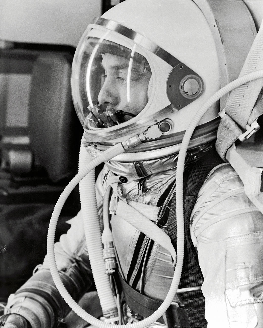 Side profile closeup photo of astronaut Alan Shepard in pressure suit with helmet