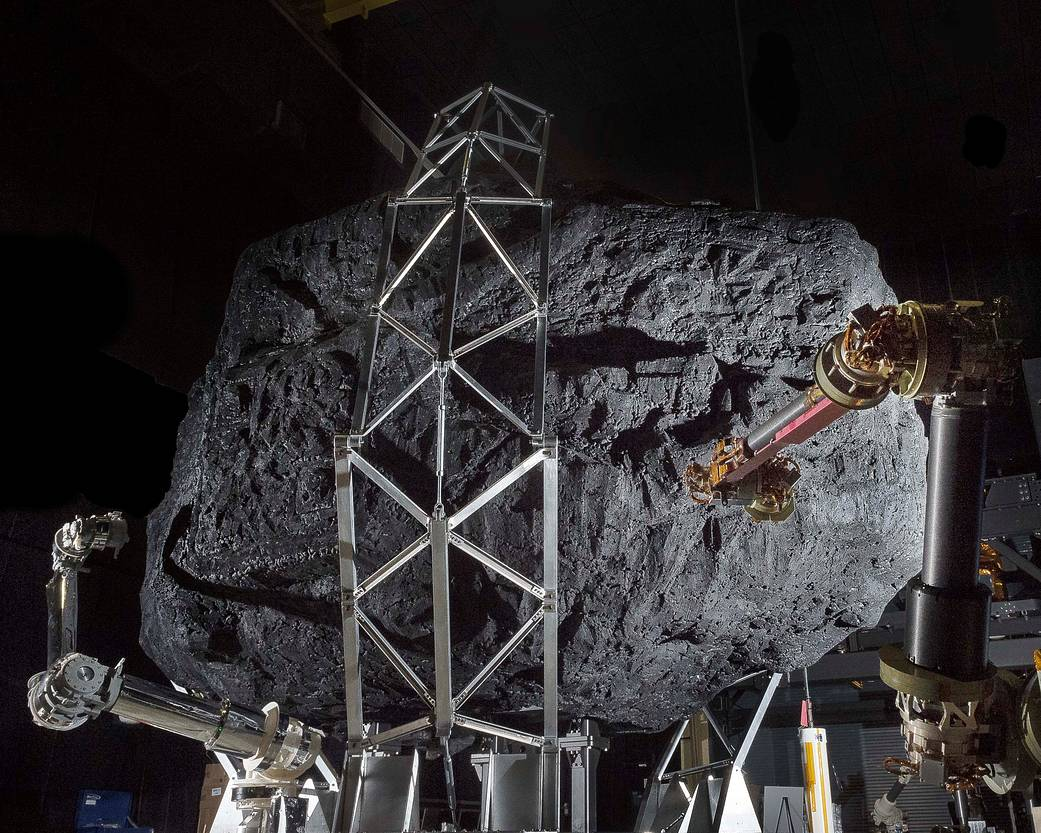 Prototype robotic capture arms with mock asteroid boulder