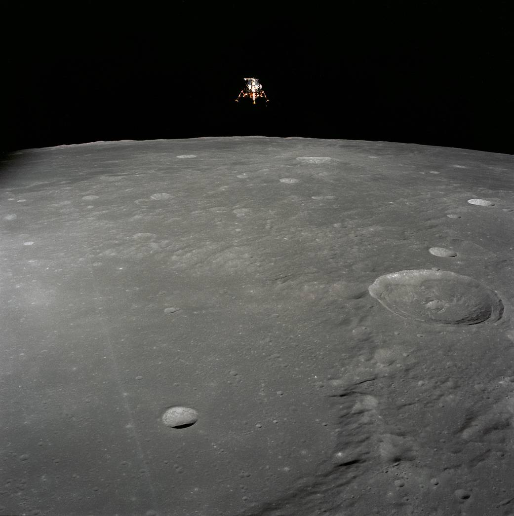 Apollo 12 Lunar Module configured for landing in lunar orbit with vast lunar surface below