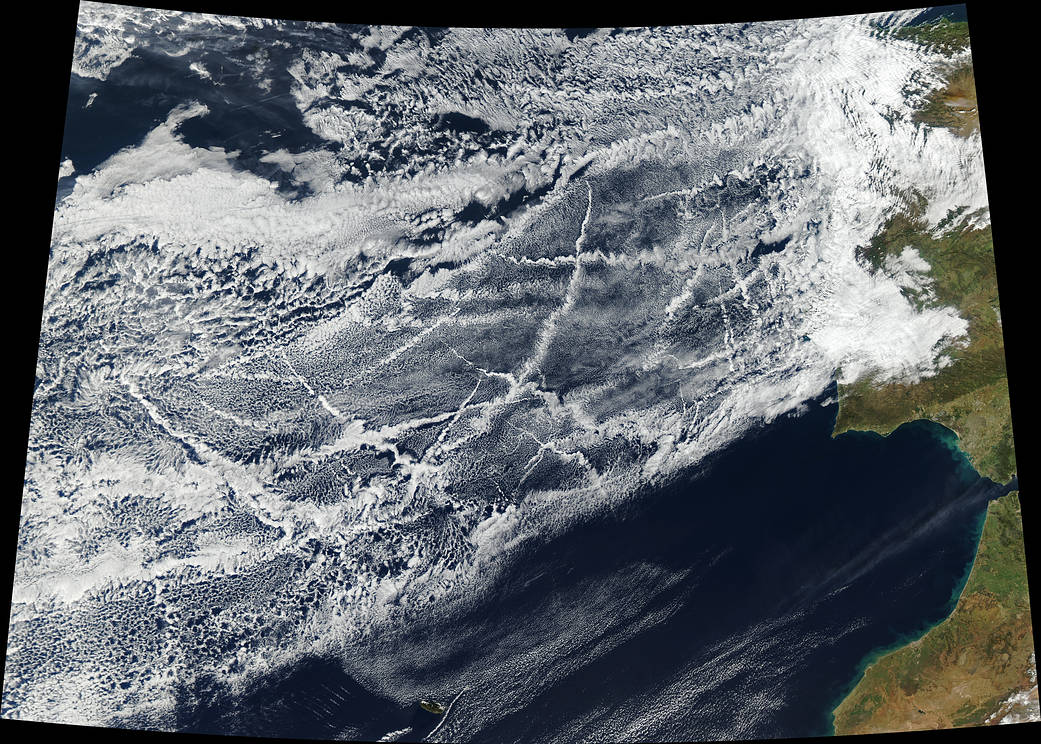 Ships churning through the Atlantic Ocean produced this patchwork of bright, criss-crossing cloud trails