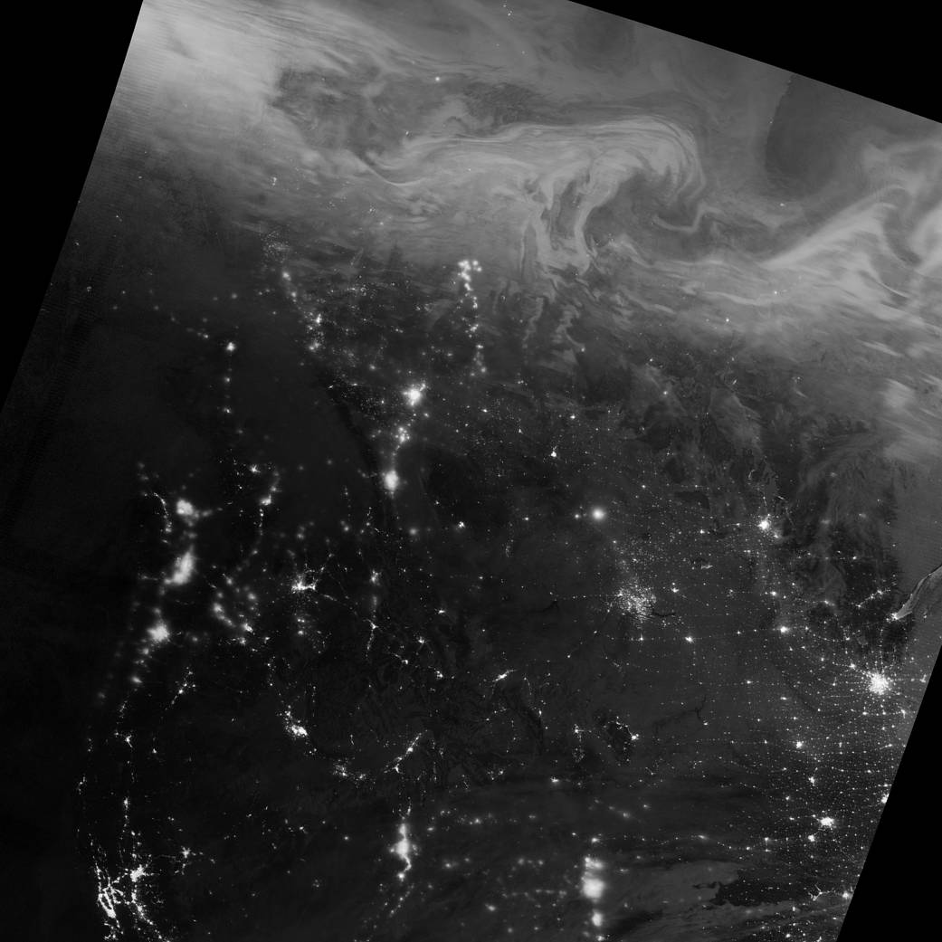 Nighttime image of Canada showing lights of aurora and cities