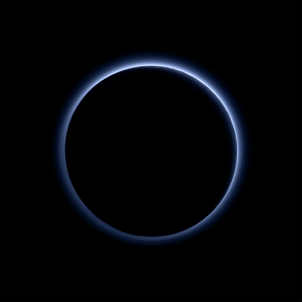 Blue haze around Pluto.
