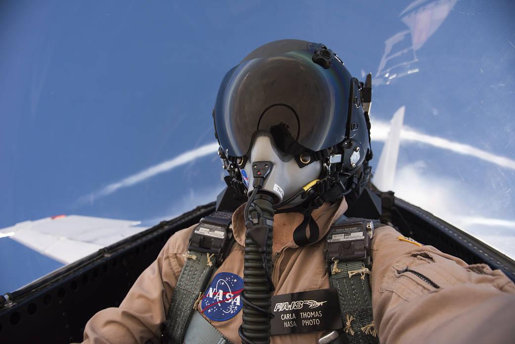 NASA photographer Carla Thomas in aircraft cockpit during supersonic flight