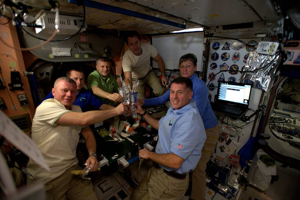 Expedition 50 crew members toast Thanksgiving