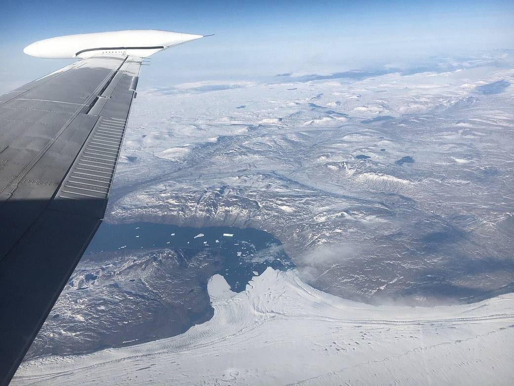 Photo from aircraft window showing glaciers below