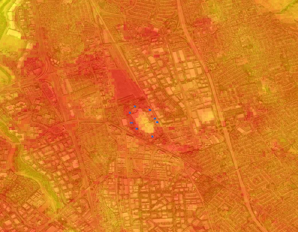 Heat map image with bright orange and yellow colors highlighting hot spots on the ground.