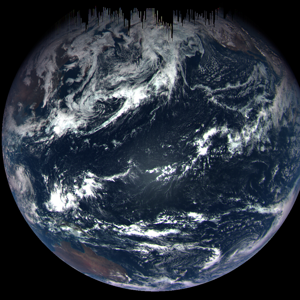 Earth from space with dark streaks in the north