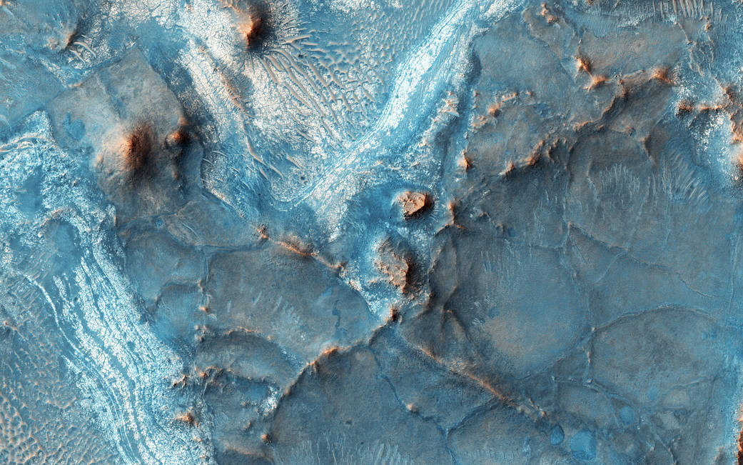 Colorful terrain on Mars surface with exposed bedrock