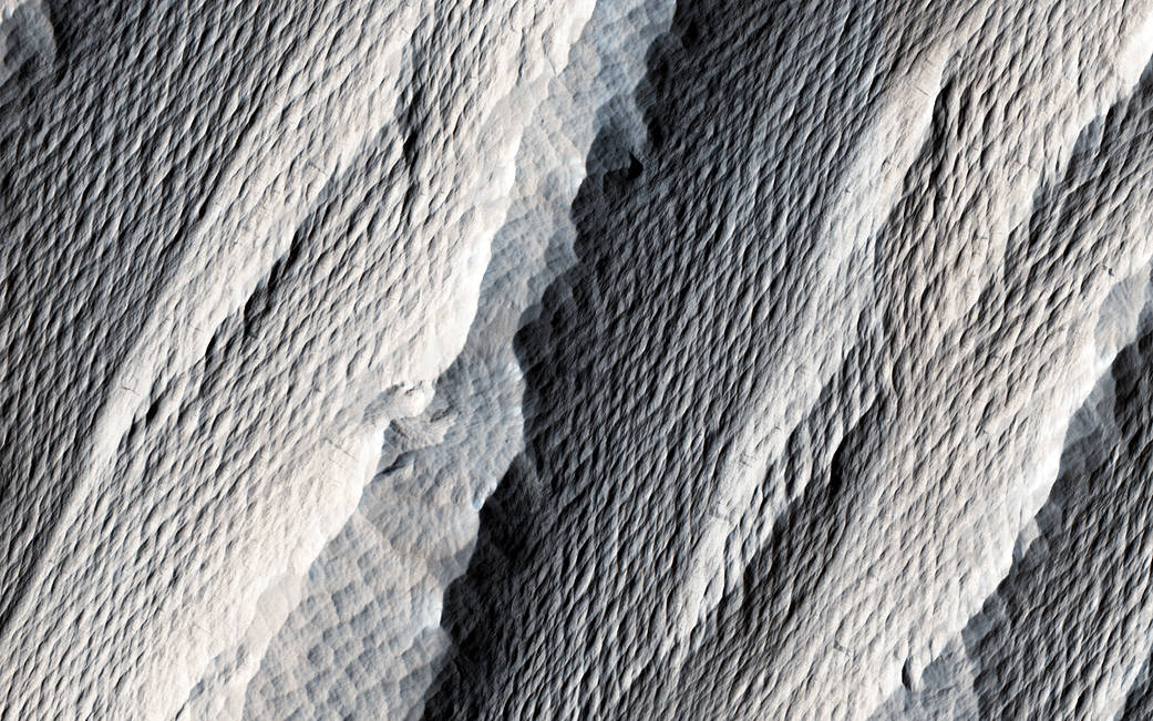 Windswept elongated hills in closeup on Mars surface