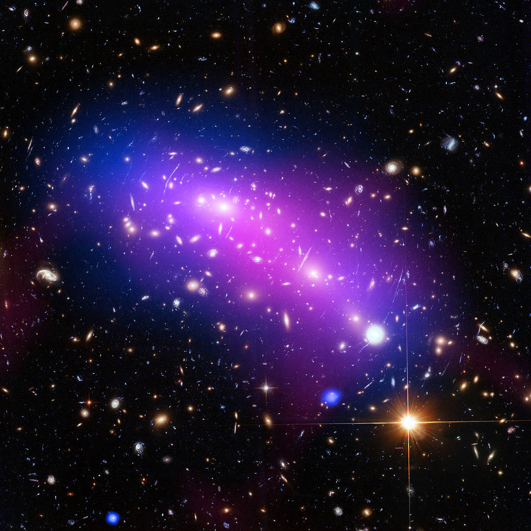 Pink, purple and blue colliding galaxy clusters