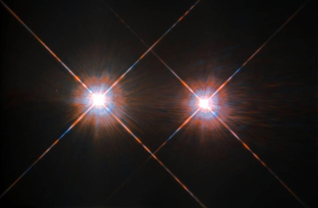 Alpha Centauri A and B glow against a black sky