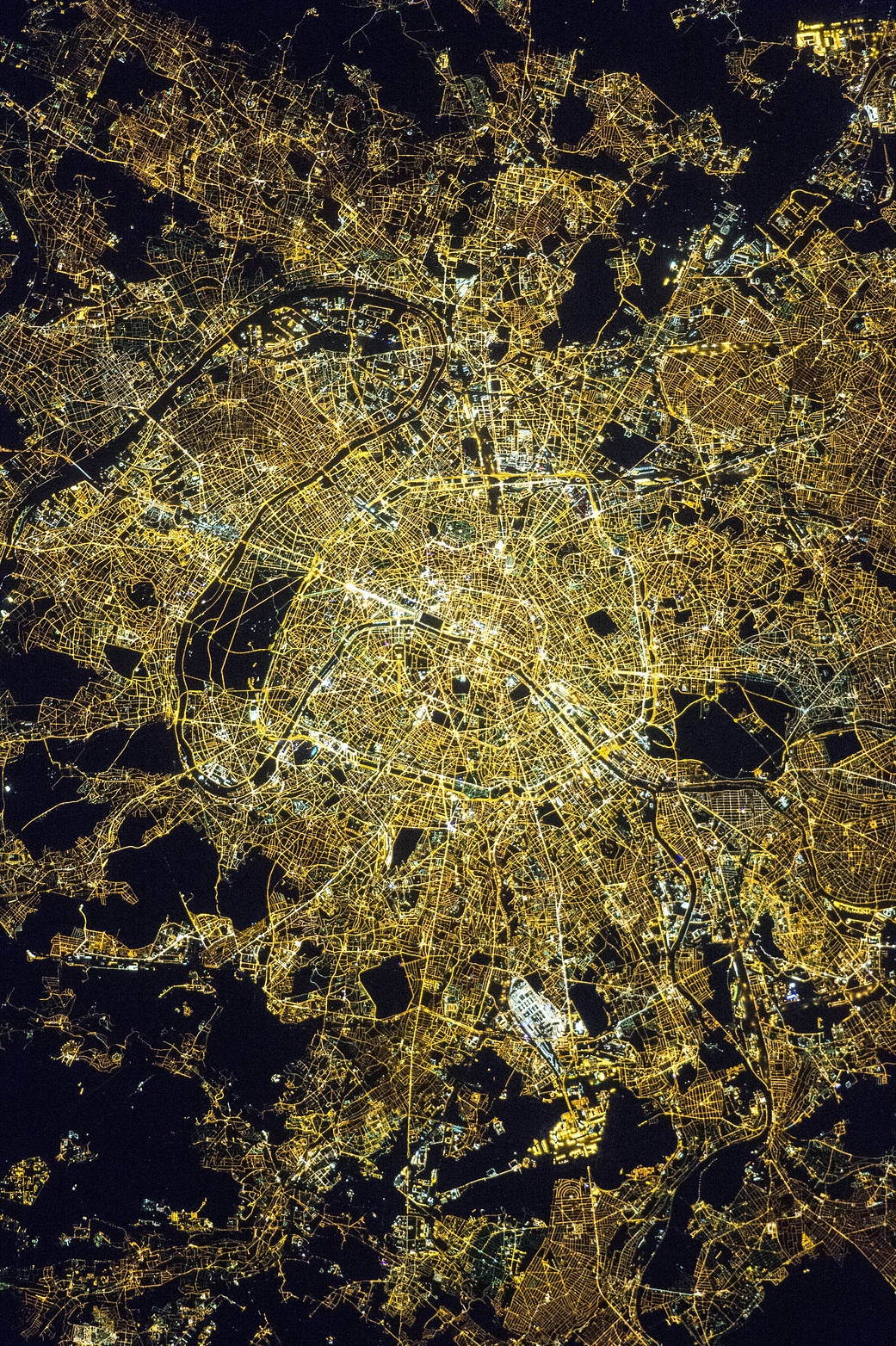 Nighttime view of the city of Paris from low Earth orbit showing bright streetlights