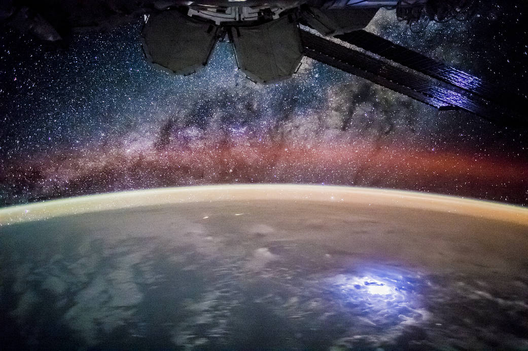 Starry sky and night lights of Earth photographed from low Earth orbit