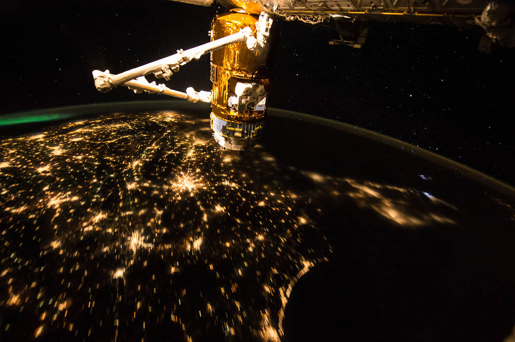 Lights of the United States at night photographed from the International Space Station with HTV cargo vehicle in foreground