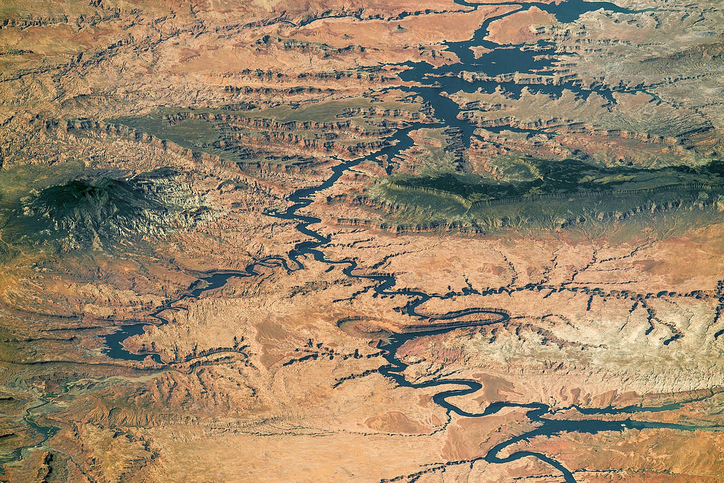 View of lake on Colorado River and terrain from low Earth orbit