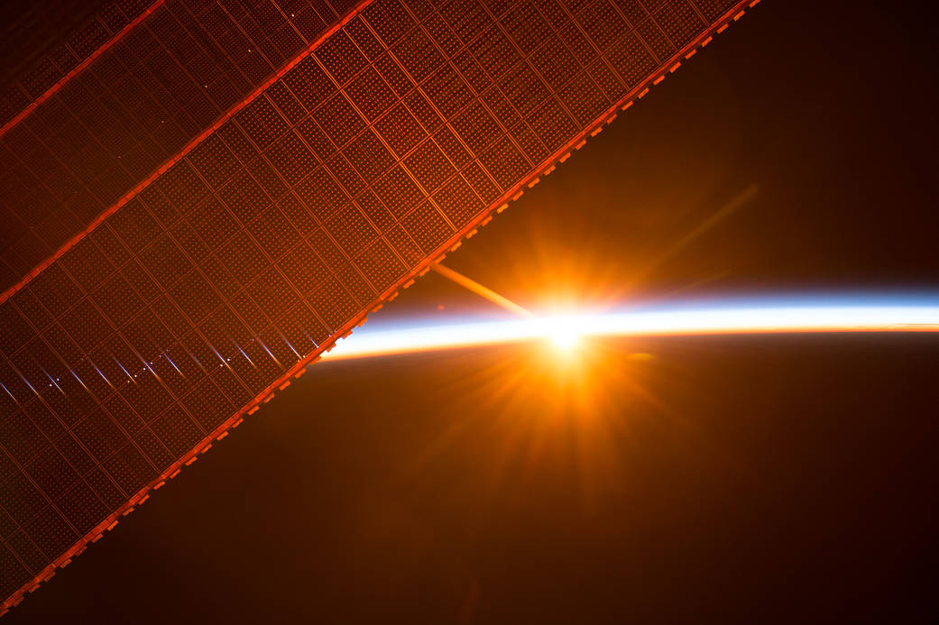 The International Space Station orbits toward the sun to experience one of the 16 sunrises the crew has every day