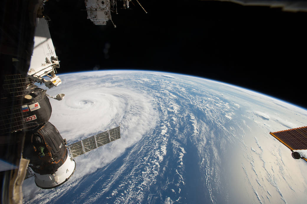 Super typhoon photographed from low Earth orbit with Soyuz spacecraft in left of frame
