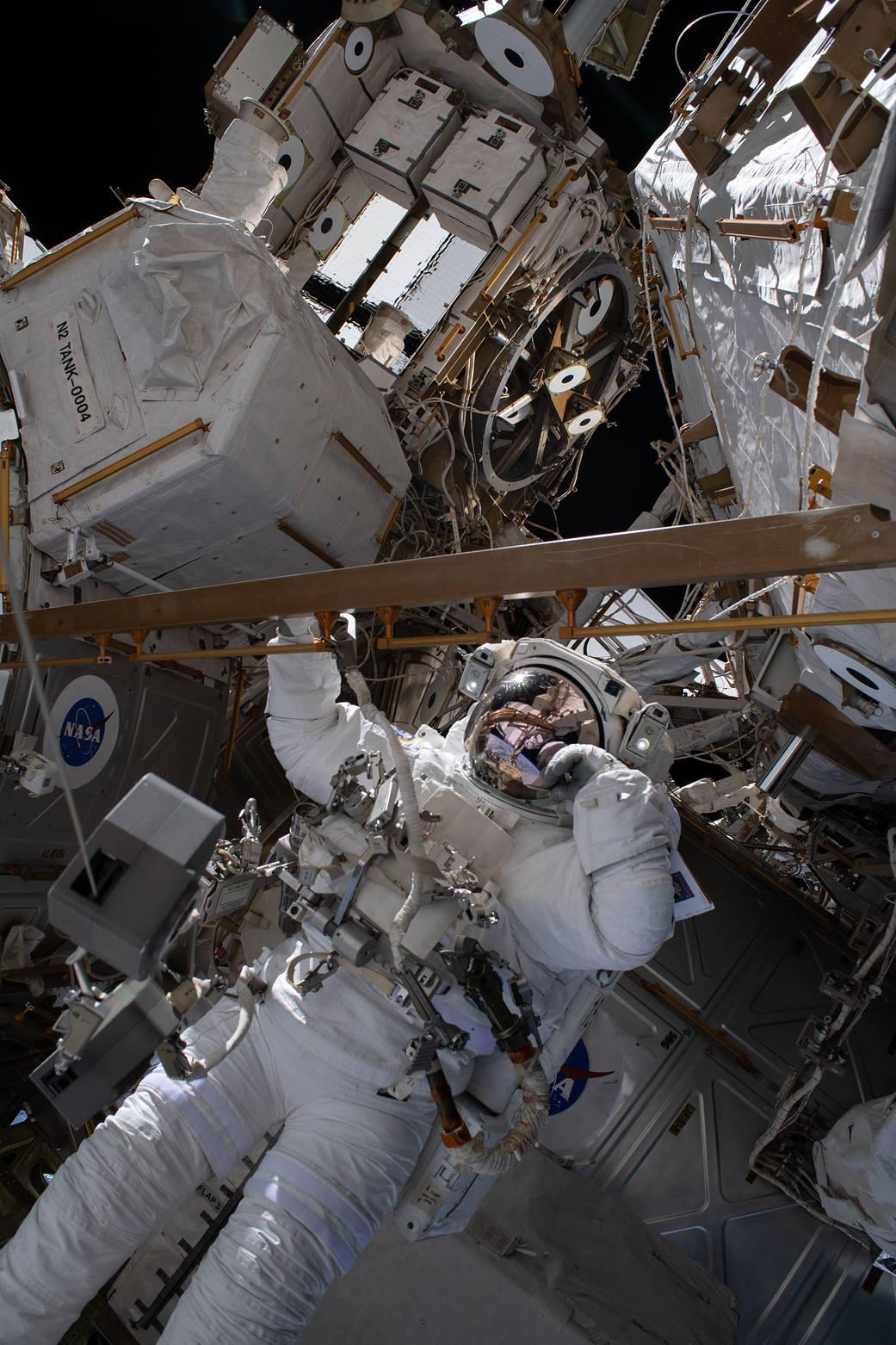Astronaut Bob Behnken conducts a spacewalk