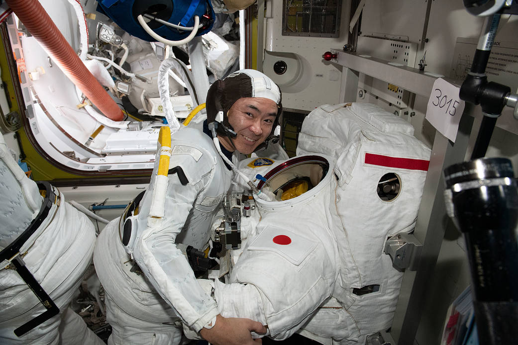 Astronaut Akihiko Hoshide conducts a spacesuit fit check