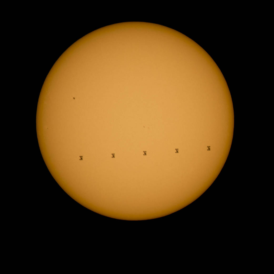 Composite image of the ISS transiting the Sun