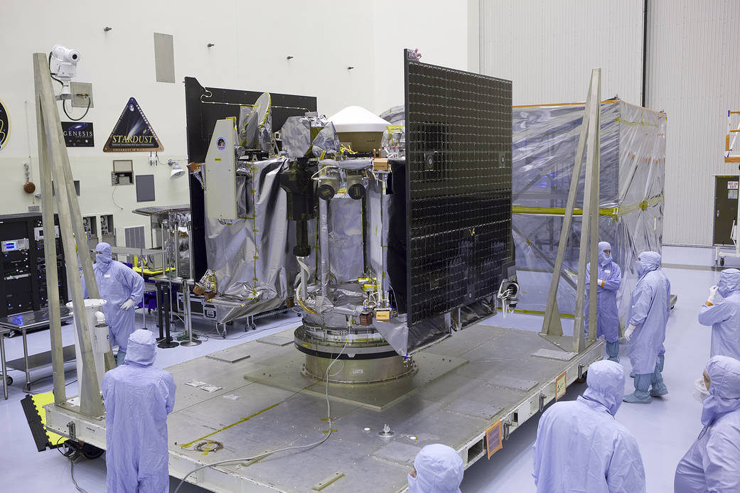 OSIRIS-REx spacecraft in clean room surrounded by technicians