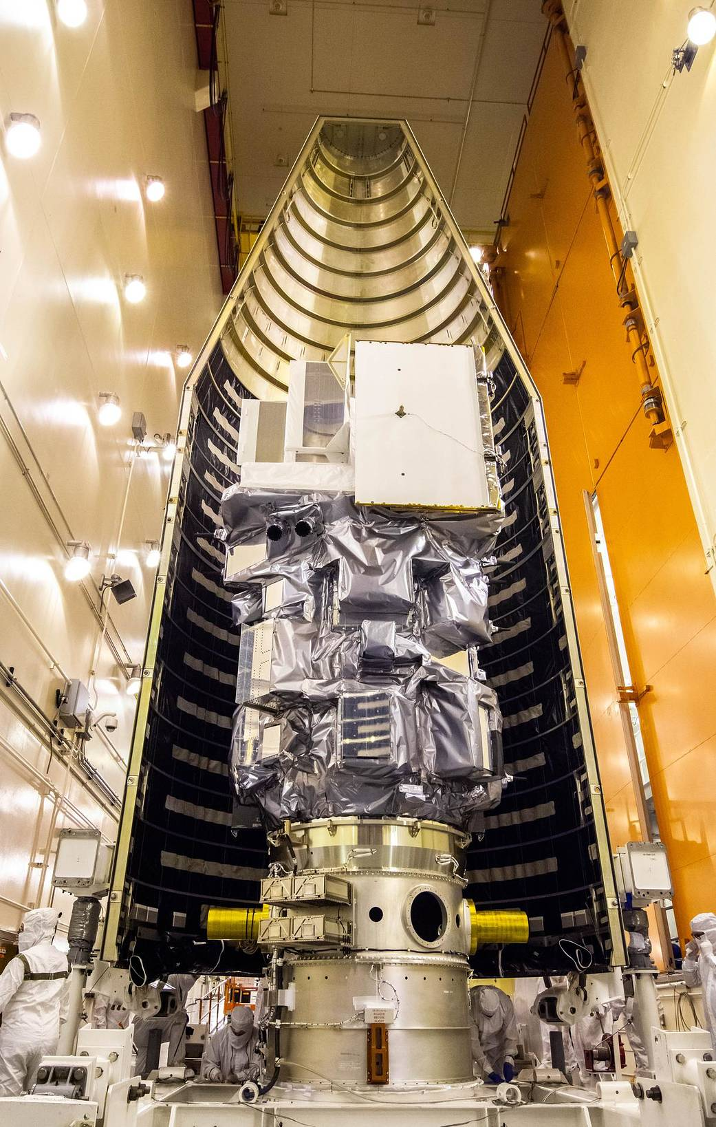Inside the Integrated Processing Facility at Vandenberg Space Force Base in California, the Landsat 9 spacecraft is moved into position for encapsulation on Aug. 16, 2021.