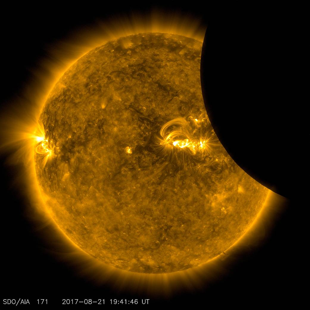 image of moon crossing in front of the sun, from SDO