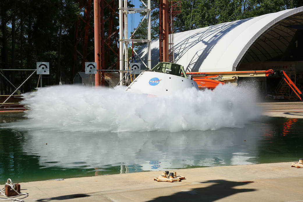 A test version of the Orion spacecraft is pulled back like a pendulum and released, falling 20 feet into the water.