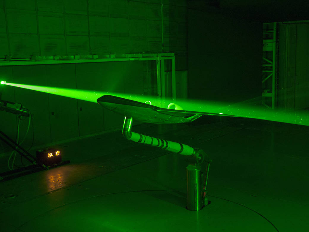 Engineers at NASA Langley used lasers inside the 14-by 22-Foot Subsonic Tunnel map how air flows over a Boeing BWB model.