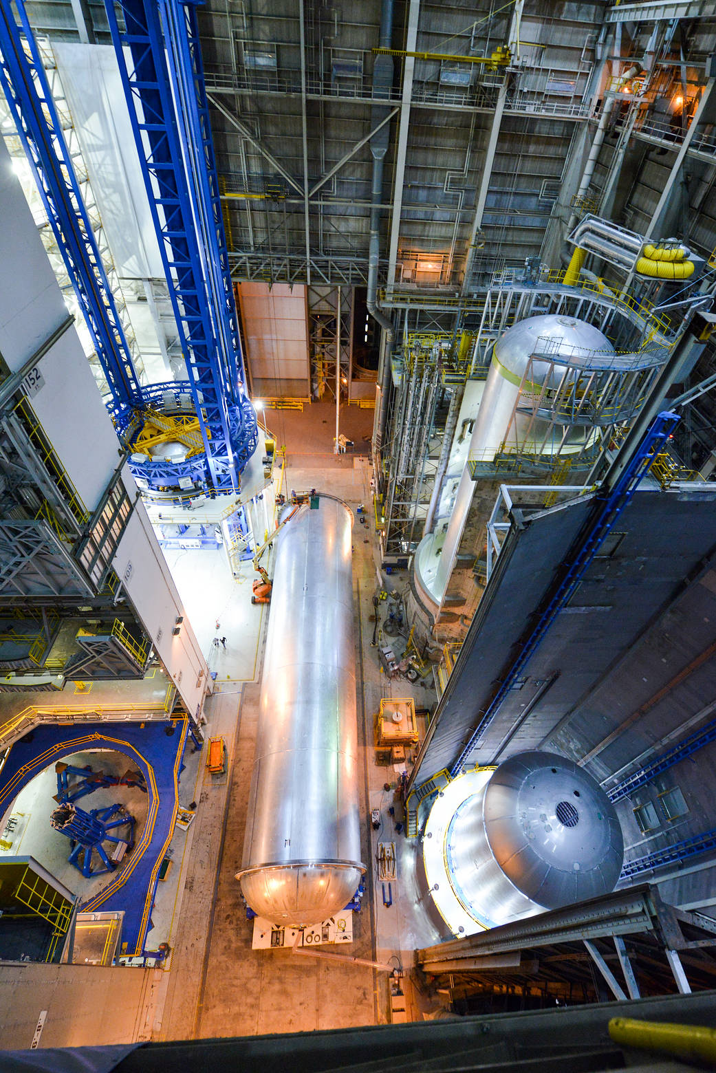 Inside the Vertical Assembly Building at NASA's Michoud Assembly Facility, four fuel tanks are being built and processed.